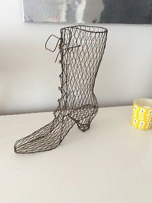 A Vintage Old Wire Boot With Lots Of Detail