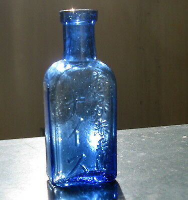 Collectable Chinese medicine bottle (Cobalt Blue with writing)