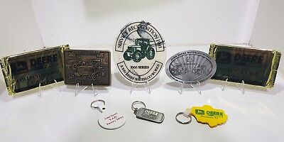 John Deere collectibles lot belt buckle, medallions, playing cards and key rings