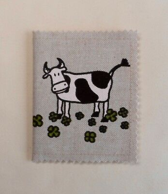 Handmade needle book. Linen look cotton fabric with a print of cows. 10x8cm.