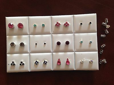 JOB LOT-12 pairs of 12  different styles coloured diamante stud earrings.UKmade.
