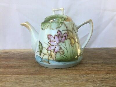 Vintage Chinese teapot with inlaid gold and flowers—good condition