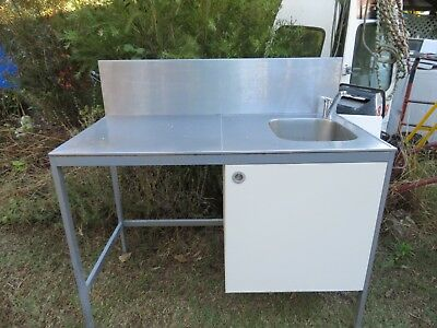 stainless sink on stand with splashback