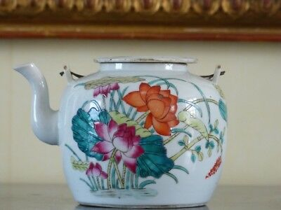 Antique Chinese teapot. 19th century porcelain teapot with peonies.