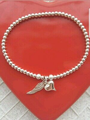 silver plated heart and angel wing stretchy stacking bracelet