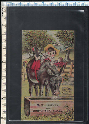 MW EASTMAN Boots & Shoes Victorian Trade Card; Boy Riding Mischievious Mule