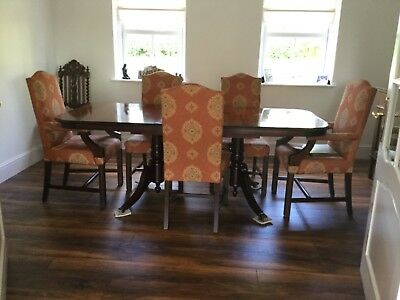 Mahogany dining suite with extending oblong table