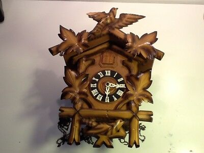 Vintage Swiss Cuckoo Clock, Bird and Leaf carved frontage sold spares or repair
