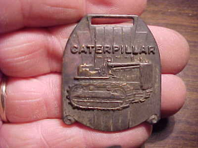 Watch fob, Caterpillar Tractor Co-Peoria Illinois-metal detector find