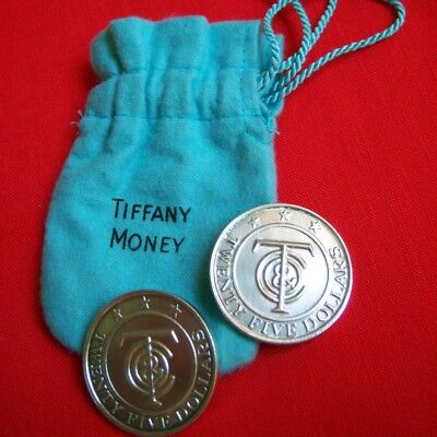 Two TIFFANY MONEY Large Coins