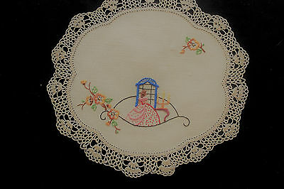 Vintage beige round cloth/doily with hand embroidered crinoline lady.
