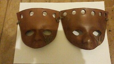 2 .pottery clay face masks.. 1is marked with maker pls look