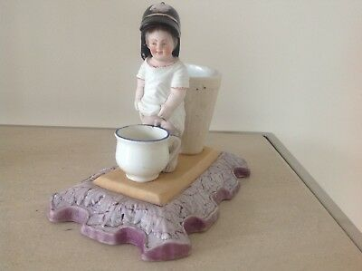 "Francis Gardner Russian Porcelain A ""spill Vase With A Figure Of A Peeing Boy"""
