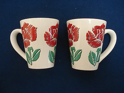 PAIR OF MATCHING COLORFUL Tb TRADING COMPANY MUGS