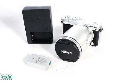 Nikon 1 J5 Mirrorless Digital Camera, Silver Body with Black Leather {20.8}