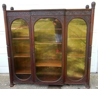 Antique American Intricately carved anthacus three door  Bookcase 64 inches
