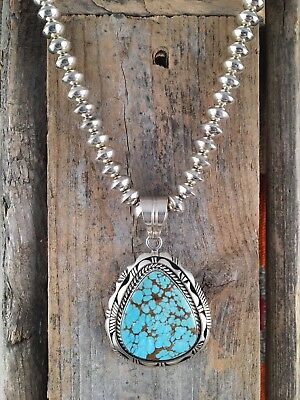 Native America handmade sterling silver beads with Number 8 turquoise pendant.