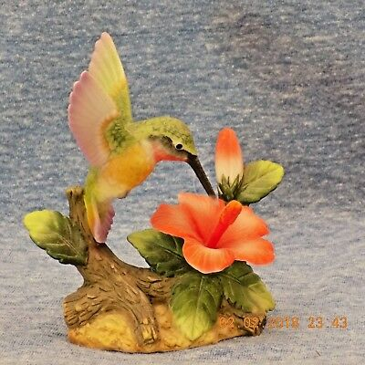 ceramic porcelain hummingbird figure collectable with red hibiscus flower