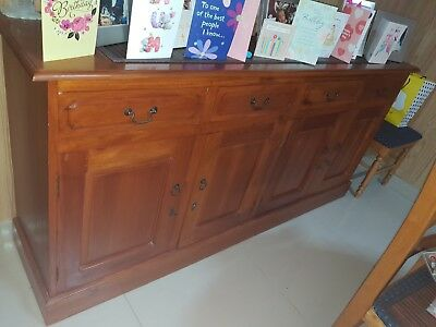 solid wood buffet unit with 4 draws and 4 cupboards in excellent condition