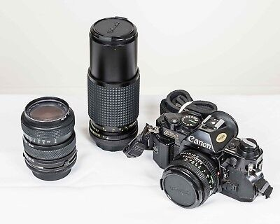 Canon AE-1 35mm SLR Film Camera with FD 50 mm f/1.8 and two zoom lenses
