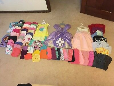 64 pc. Lot Of Girls Size 3T to create a wardrobe.