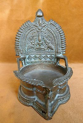 Indian copper alloy Puja lamp depicting Lakshmi flanked by elephants Alter piece