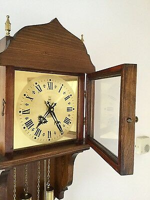 Antique style wooden wall clock with brass face