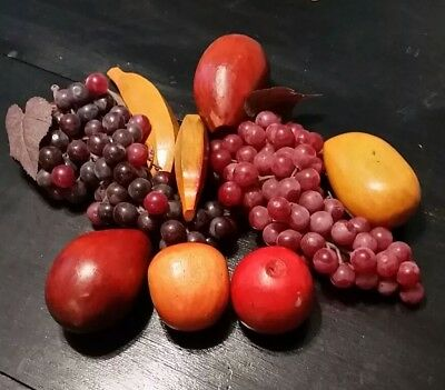 Vintage colored wooden fruit and plastic grapes
