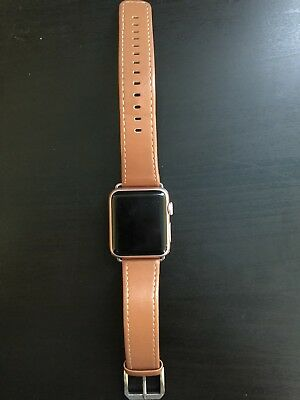 apple watch series 1 38mm rose gold with brown leather band and charging dock