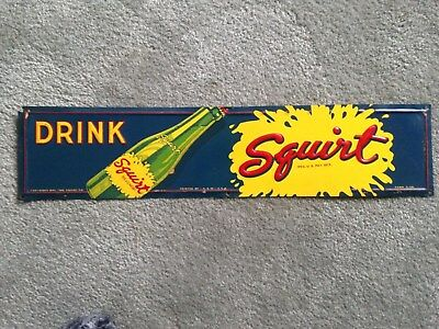 vintage squirt sign embossed metal