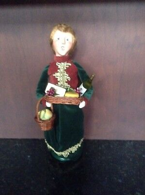 2009 Byers Choice Caroler Woman W/Wine Bottle, Cheese Tray and Basket of Pears