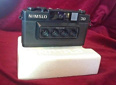 Nimslo 3D camera outfit and flash, complete, unused.