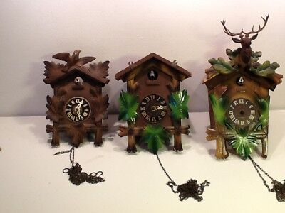 A Trio of Vintage Swiss Cuckoo Clocks, Bird/Leaf frontage sold spares or repair