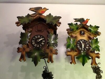 A Pair of Vintage Swiss Cuckoo Clocks, Bird/Leaf frontage sold spares or repair