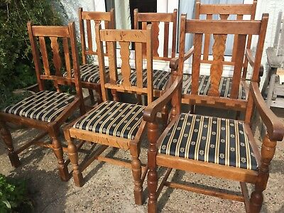 Six antique, solid oak dining chairs including two carvers