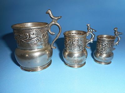 Set Of 3 White Metal Embossed Miniature Tankards With Bird On Scroll Handles