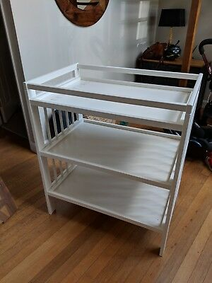 White Ikea baby changing table with shelves, used in good condition
