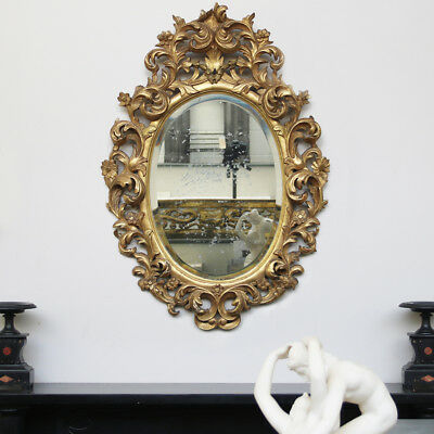 Origina large mid 19th Century French Rococo gilded carved wood oval wall mirror
