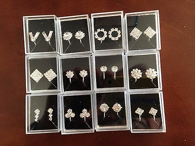 JOB LOT- 24 pairs of crystal diamante clip on earrings.Silver plated.Gift boxed.