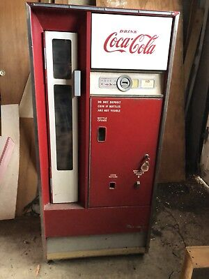 Original vintage Coca Cola bottled vending machine. In working condition. 1960's