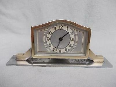 134 / HIGHLY STYLISED 1920s - 1930s ART DECO CROME PLATED SWIVEL MANTEL CLOCK