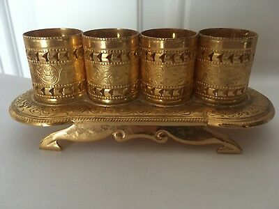 VINTAGE LIPSTICK HOLDER, gold, intricate detailing, holds 4, good condition