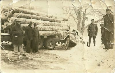 Log Truck And Car Accident On Slippery Winter Roads - As Is Real Photo
