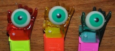 Pez Set of THREE (3) CRYSTAL Psychedelic Eyes - HARD TO FIND! Red, Purple, Green