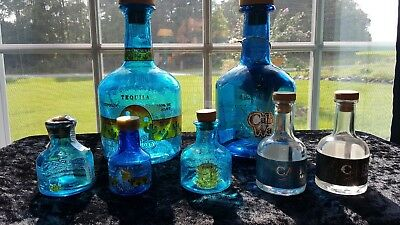 Cabo Wabo tequila bottles. 5 50ml and 2 750ml bottles.