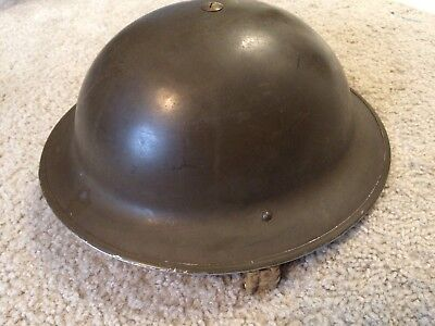 WW2 british 1942 dated  with liner close to a size 7  with original  chin  strap