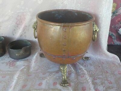 Antique Copper large French urn, brass lion head handles and legs, planter old
