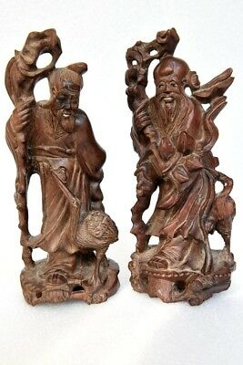 A Vintage Pair of Carved Hardwood Chinese Immortal Figures