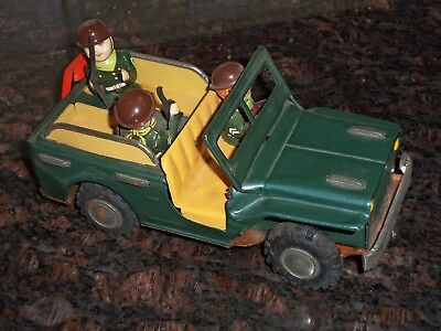 vintage tin army jeep /three american soldiers -makes sound when wheels move