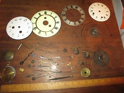 Antique Clock parts -enamel dials and watch hands etc . 2 pendulums / hands
